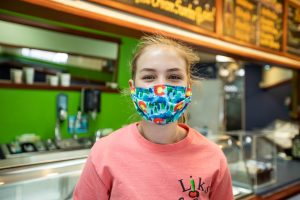 Girl happy with a colorful Colorado mask