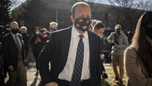 Gov Jared Polis wears a Colorado mask while working
