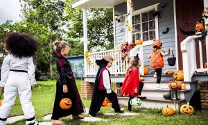 Children flock to houses for trick and treat on Halloween