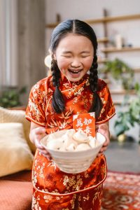 little chinese girl in Lunar New Year with lucky money