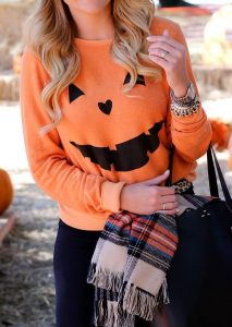 Best T-Shirts To Wear To The Pumpkin Patch with pumpkin face patterns
