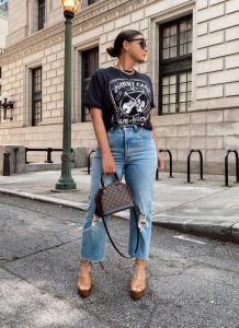 girl with The Most Expensive T-Shirts and jeans on the street