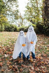 Two children are dressing in Ghost on Halloween