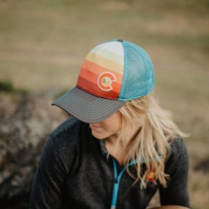 Blonde hair girl with a Colorado hat on Colorado day