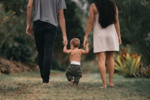 Happy family walking with mom dad and baby