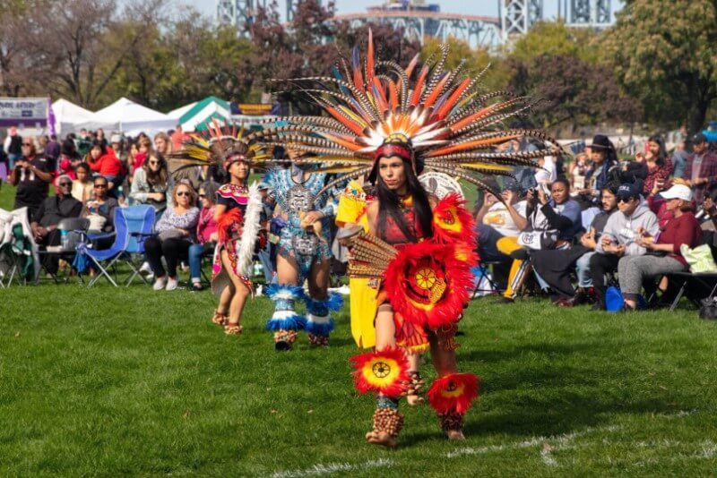 Native American Day girl wearing native red costume