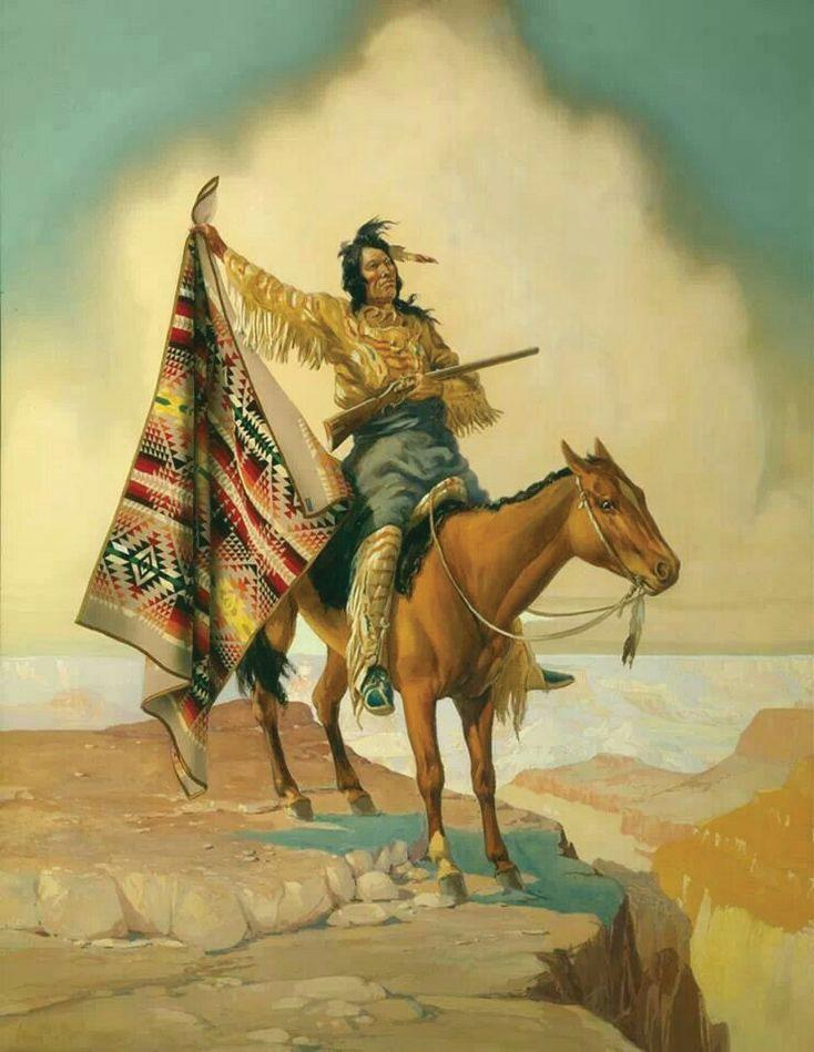 A native wearing American Indian Blankets and riding a horse