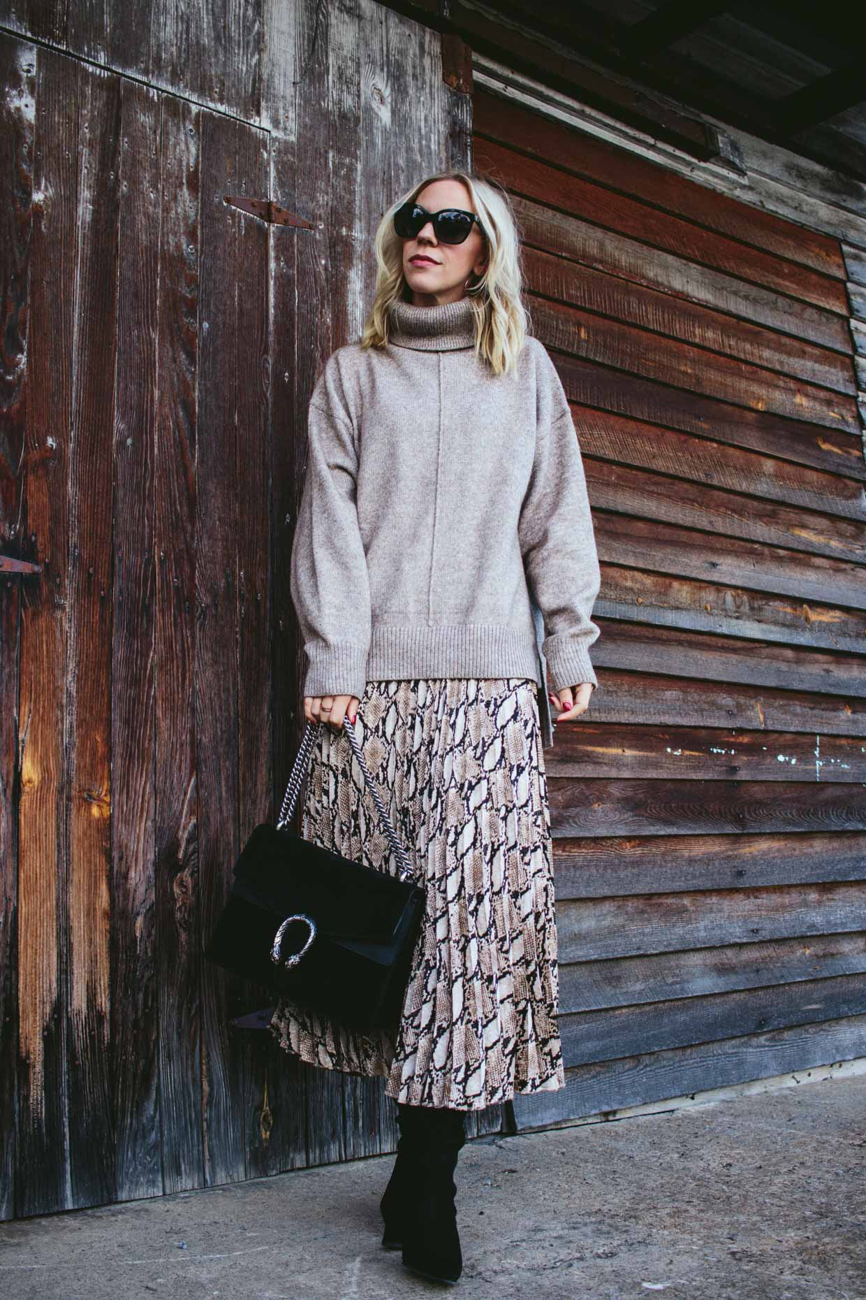 a combination of Sweater And Midi Skirt