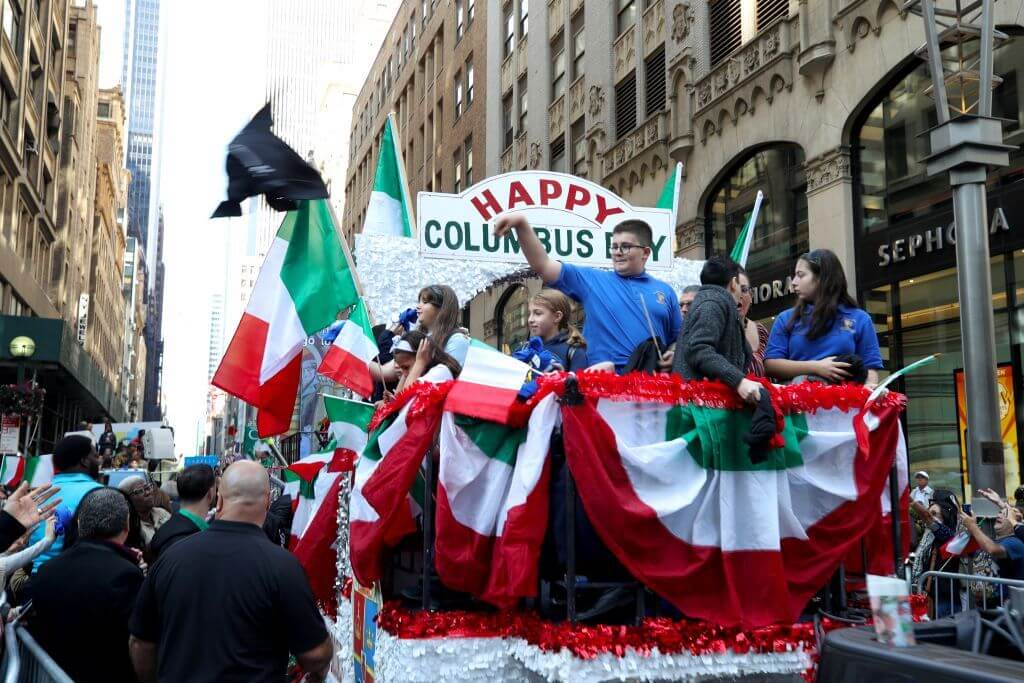 Attractive parade on Columbus Day for Americans