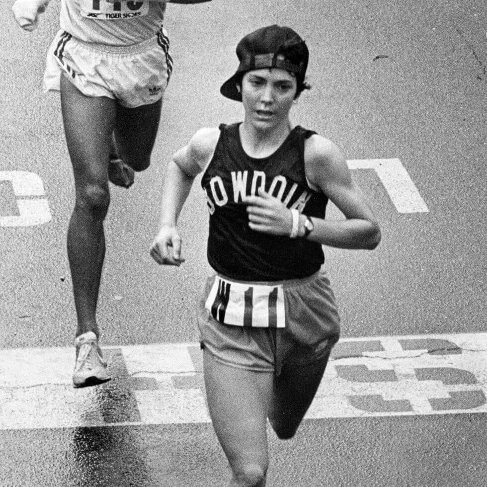 An iconic picture in the Boston Marathon about a girl finish the race