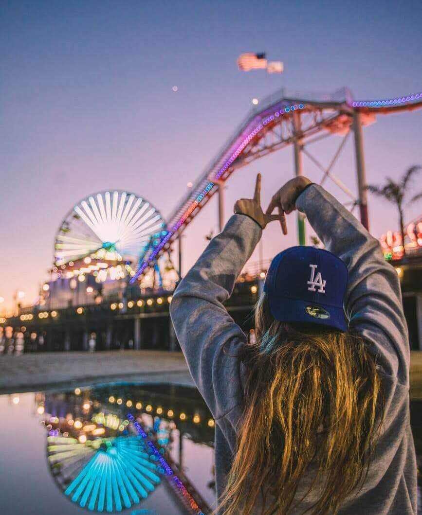 Girl wearing a cap in Los Angeles at night