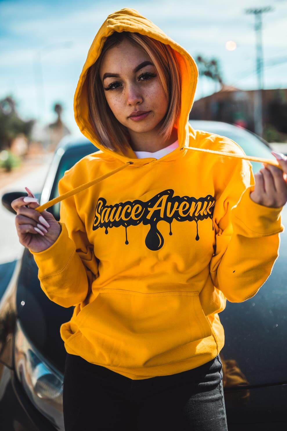 A mustard hoodie is the perfect choice for fall festival