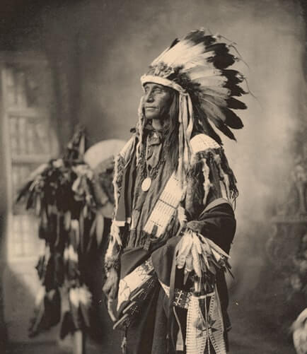 Black and White picture of a Native American man with unique fashion style