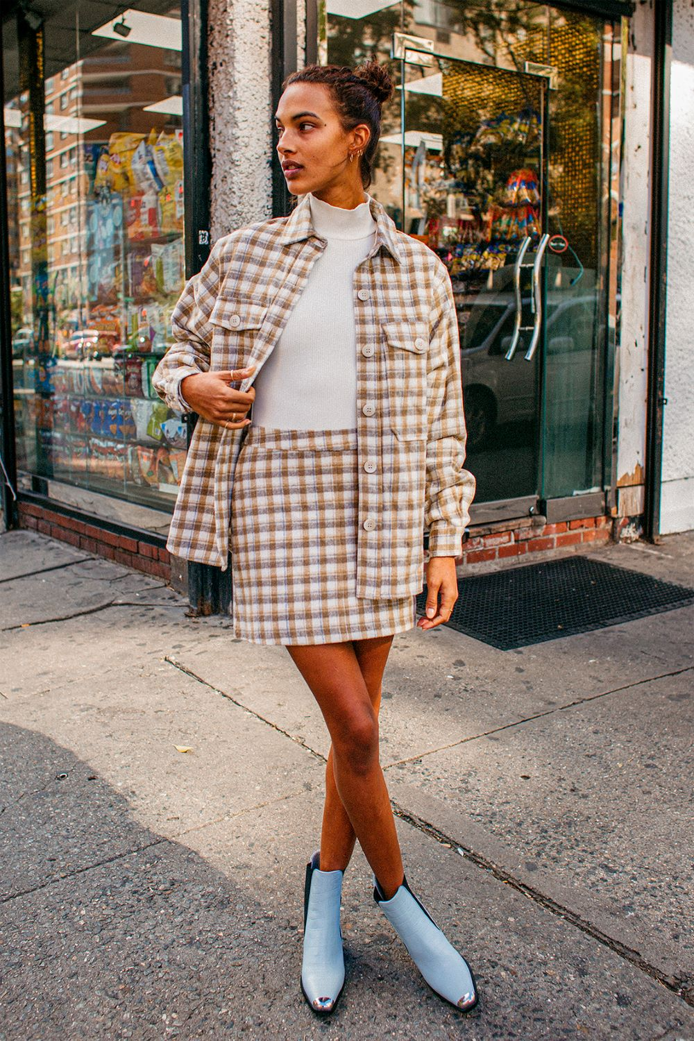 a check shacket are shorts and lace-up boots