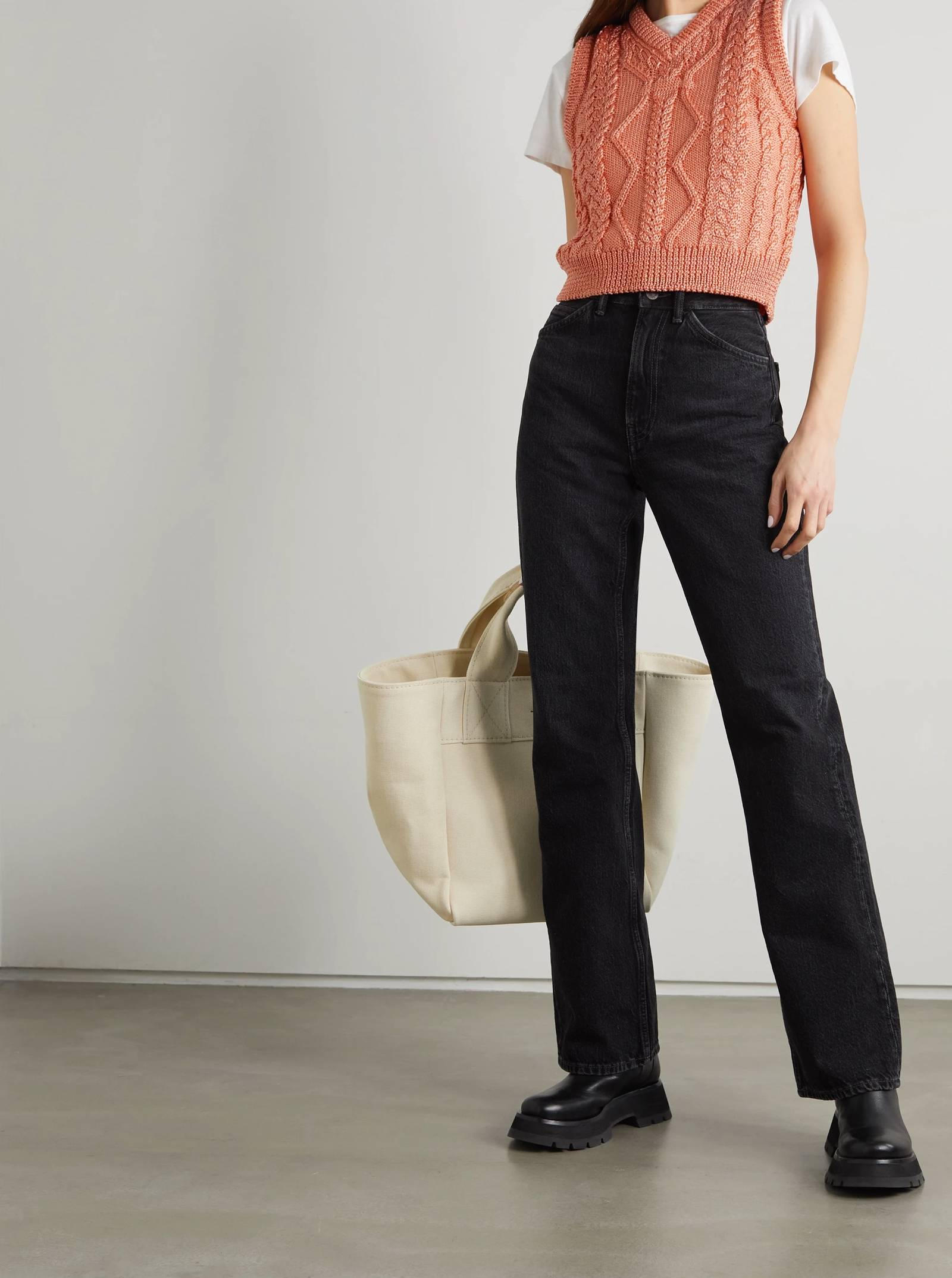 the combination of a sweater vest with jeans is perfect for an outdoor day